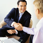 Businessman shaking hands with someone