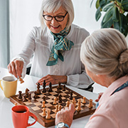Elderly ladies playing chess