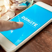 "Cellphone displaying the word ""Donate"""