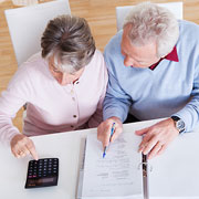 Elderly couple reviewing a simplified employee pension plan