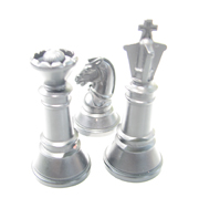 3 chrome chess pieces