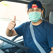Truck driver wearing a facemask