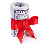 Roll of $100 bills tied up with a red ribbon