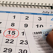Calendar with July 15th circled and a 1040 form