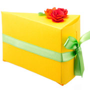 Yellow cake with red flower and a green ribbon