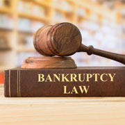 "Gavel on top of a book labeled ""Bankruptcy Law"""