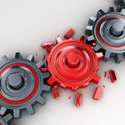 3 Interlocked cogs with the middle cog breaking apart