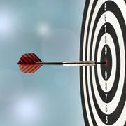 A single dart in the bullseye of a dartboard