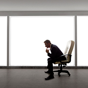 Businessman sitting in a chair in an empty room