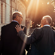 2 businessmen talking while taking a walk