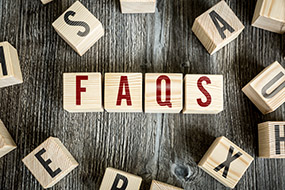 Wooden blocks with the text 'FAQs'