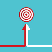 Arrow that is half red and half white pointed towards a target