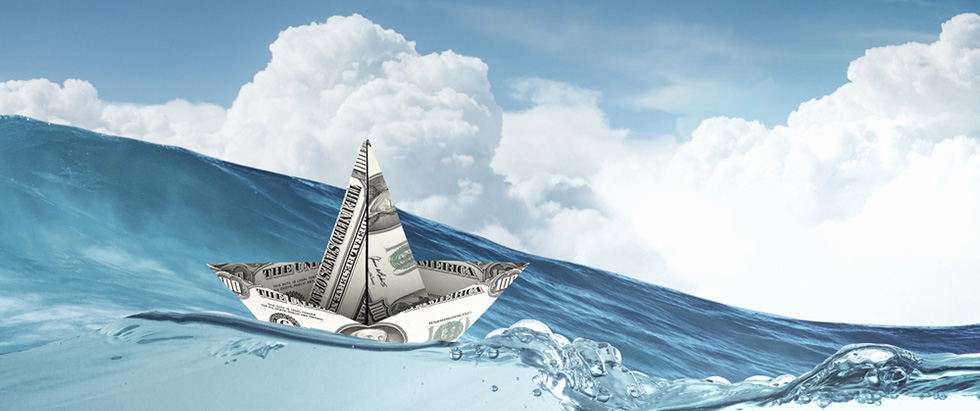 Cash Flow - Ship made of dollar banknote floating in water