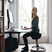 Smiling woman working at her desk at home
