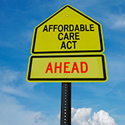 """Affordable Care Act Ahead"" yellow street sign"