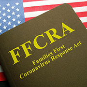 FFCRA book laying on top of the U.S. flag