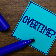 "Blue post-it note labeled ""Overtime?"""