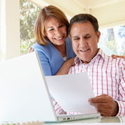 Married couple reviewing beneficiary designations