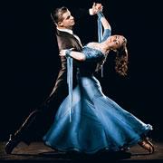 Two ballroom dancers dancing