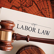 Gavel lying on top of a labor law document