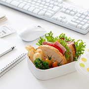Business Meal - Salad next to a keyboard and mouse