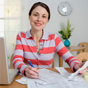 Woman reviewing financial records and documents