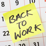 """Calendar with a Post-It Note that says """"Back to Work"""""""