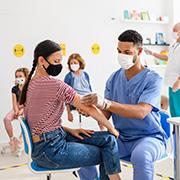 woman getting the COVID-19 vaccine
