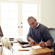 construction firm owner working from his home office