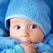 Baby wrapped up in a blue towel