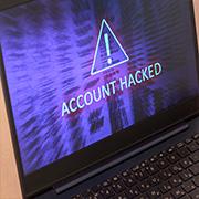 "Laptop screen displaying ""Account Hacked"" alert"