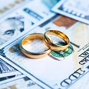 Wedding rings on $100 bills
