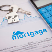 mortgage rates document and key to a house
