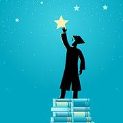 graduate reaching toward the stars