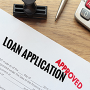 """Loan application stamped """"Approved"""""""