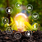 """lightbulb """"growing"""" in the ground - ESG concept"""