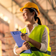 female manufacturing professional holding a clipboard