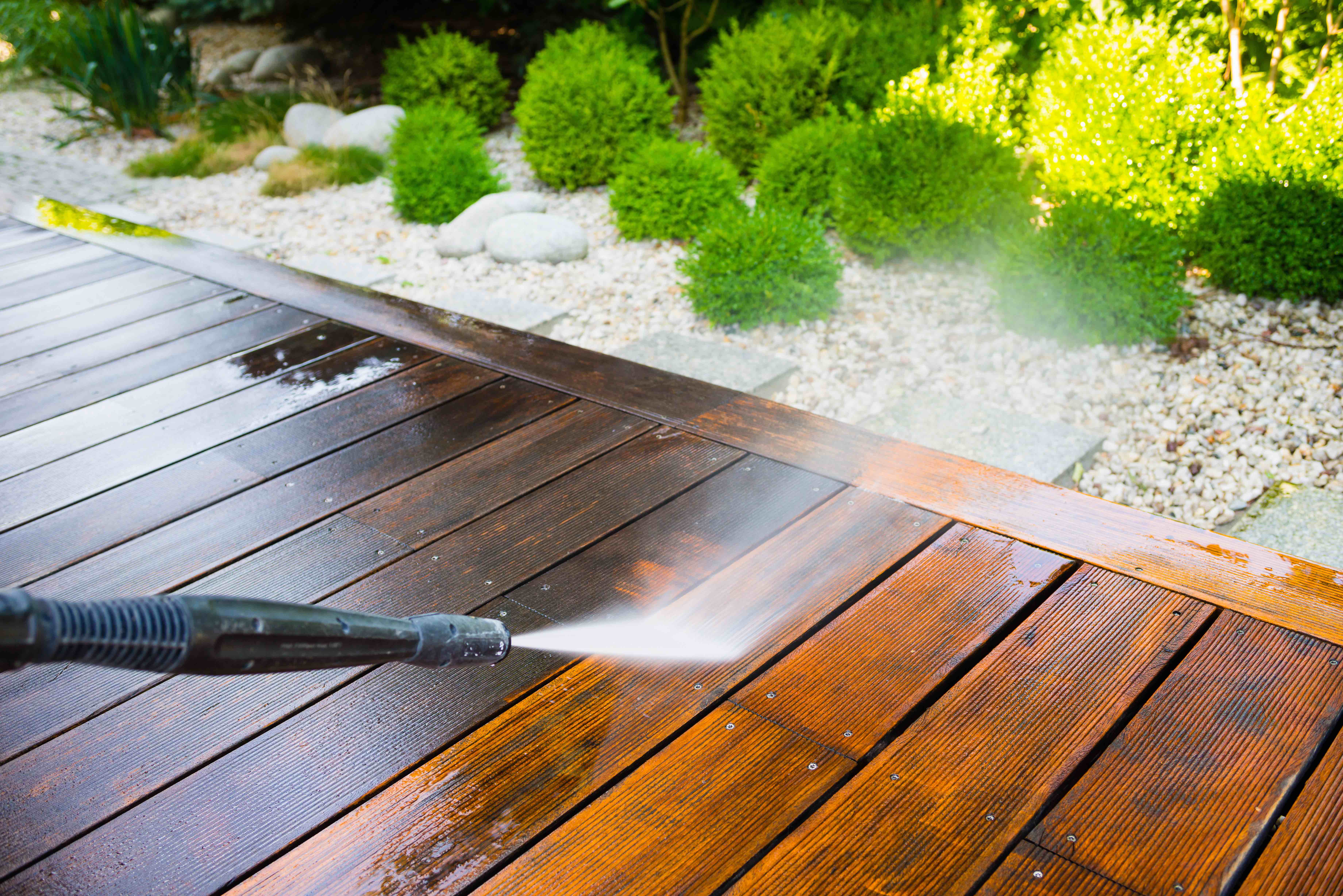Pressure washing residential wooden terrace