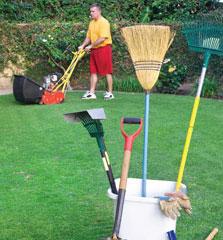 Man helping elderly lady with yard work