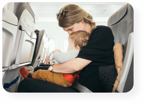 mom and baby traveling by plane - Starshot Travel & Hospitality solutions