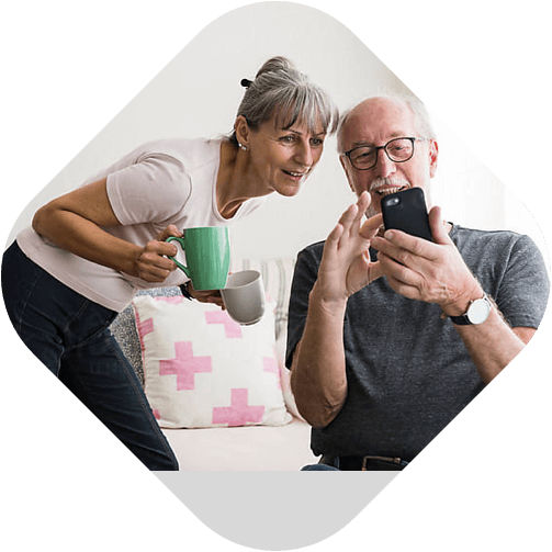 Old couple using mobile app
