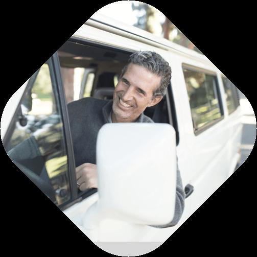 man driving a van