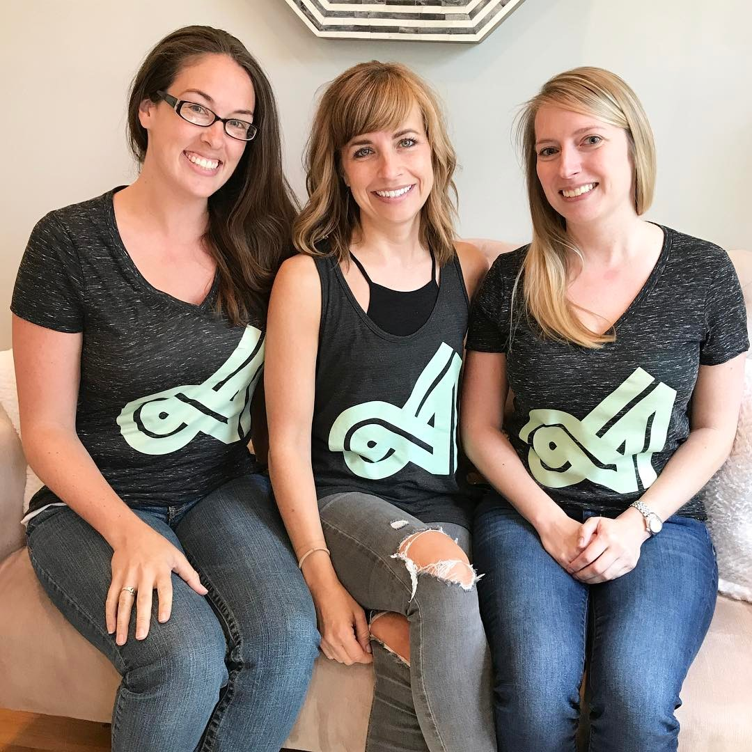 Team members wearing the Accountfully shirts