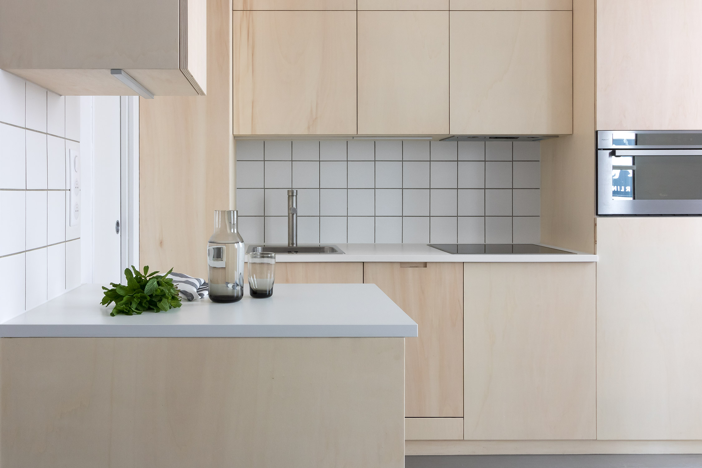 Japanese style, minimal, modern, open-plan, plywood kitchen with grey oak floor and white tiles