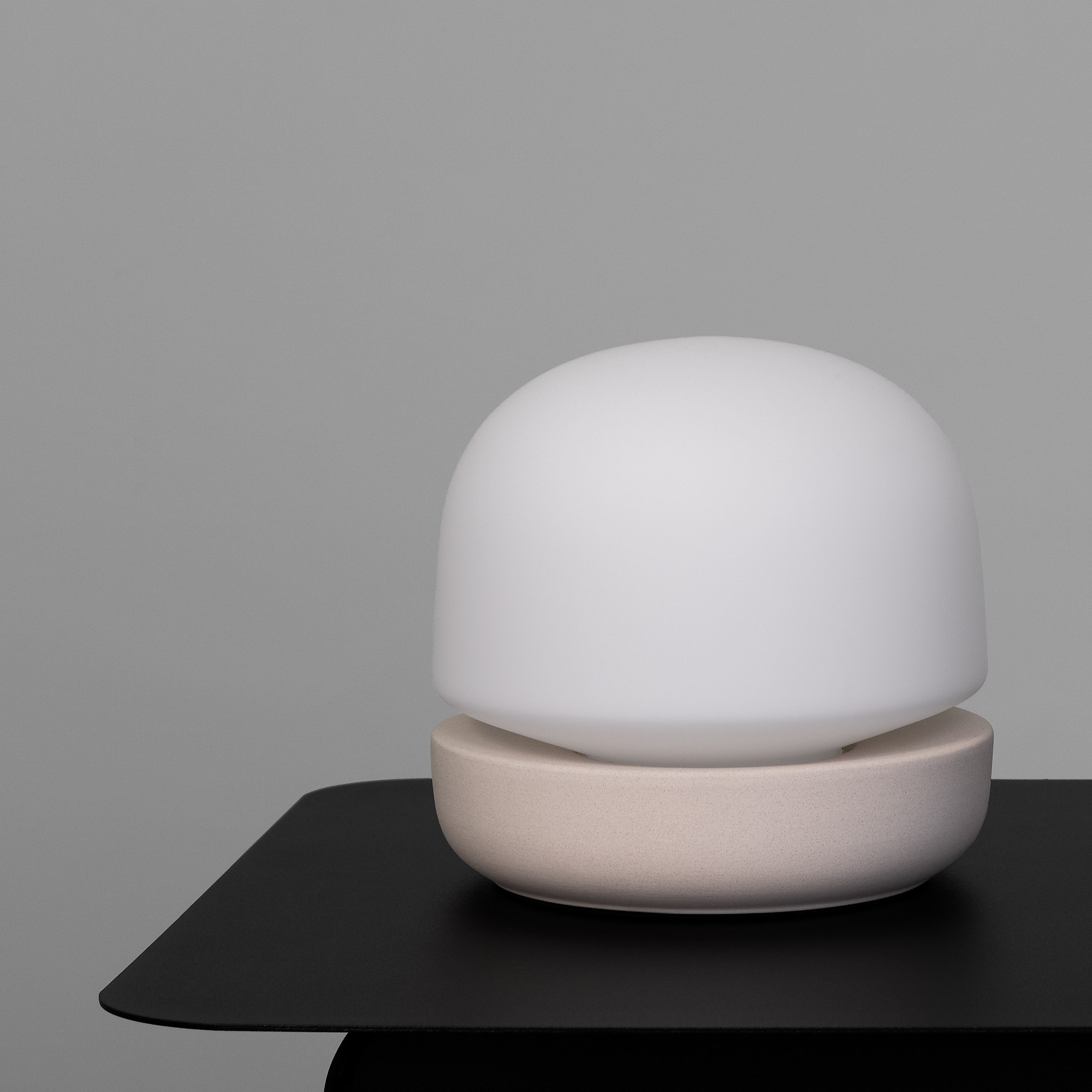 Modern black metal side table with ceramic dome lamp