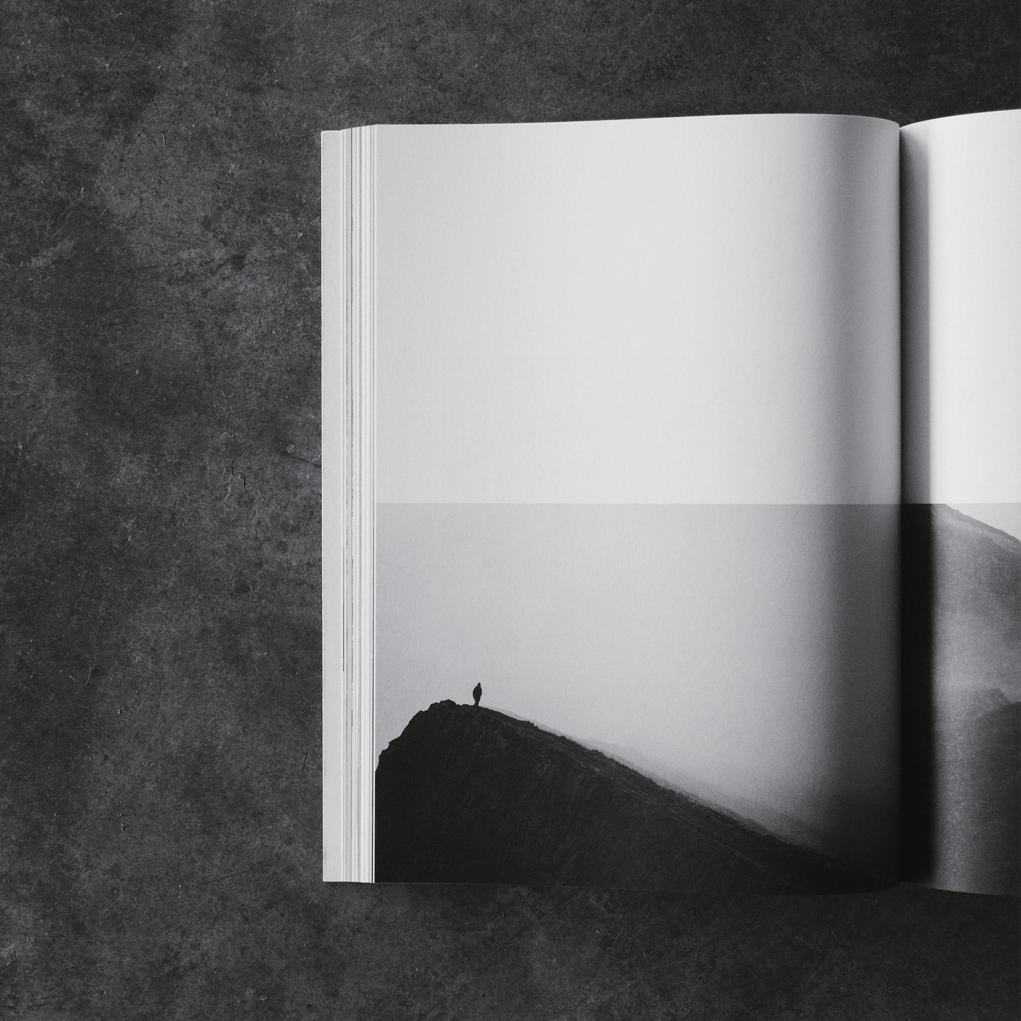 black and white open art travel magazine