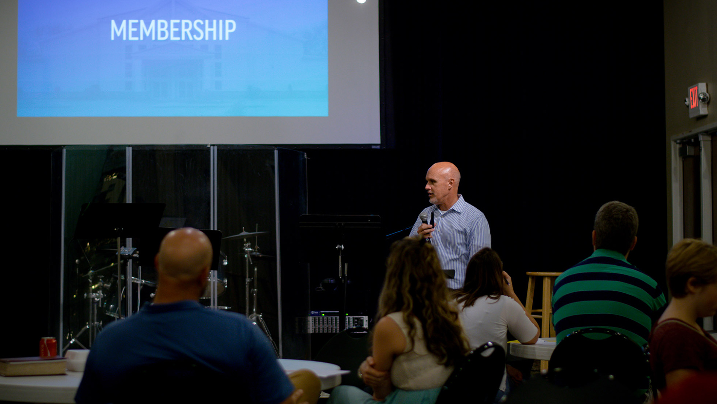 A pastor speaking at church membership class