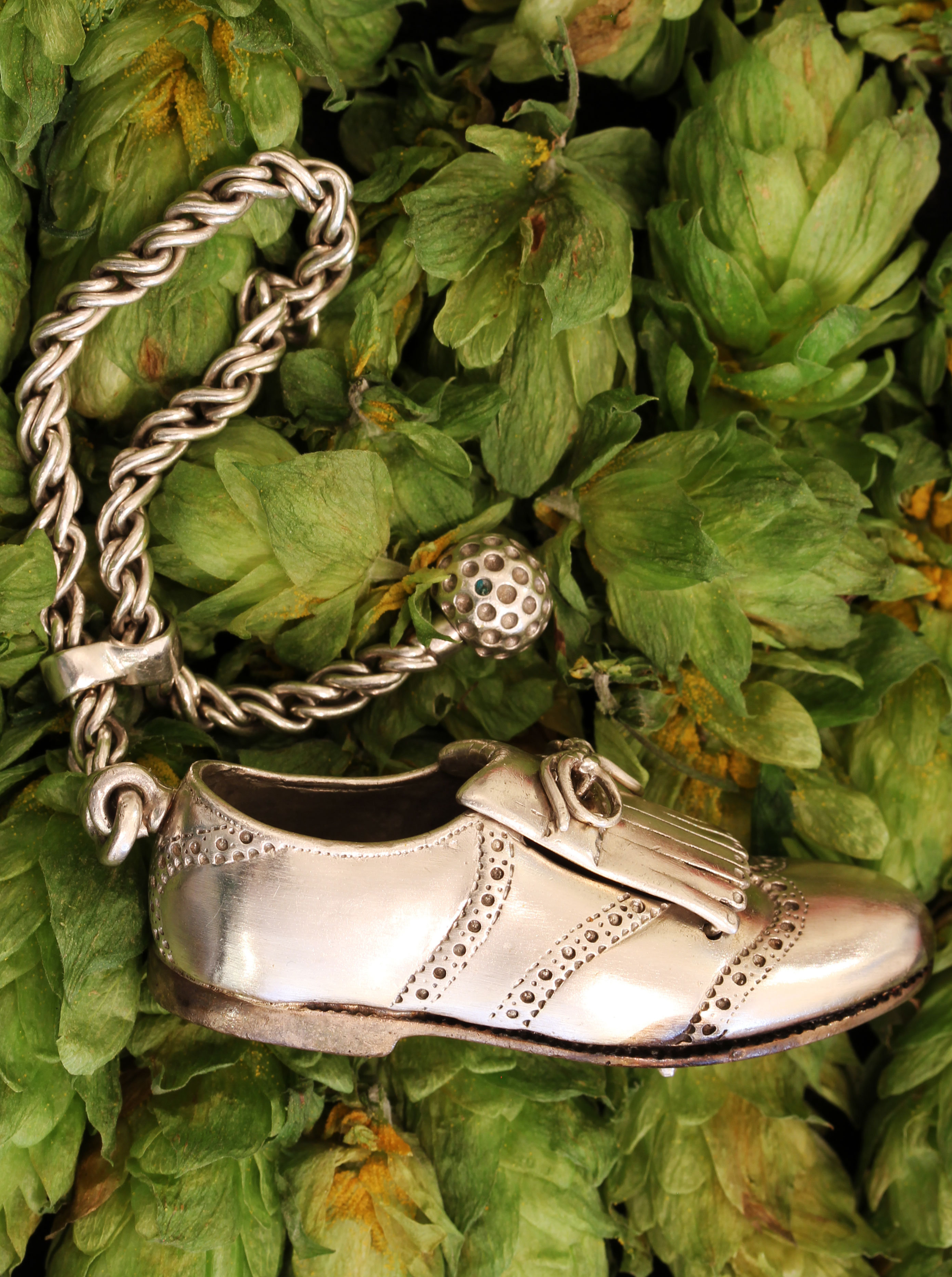 Silver key chain with golf shoe
