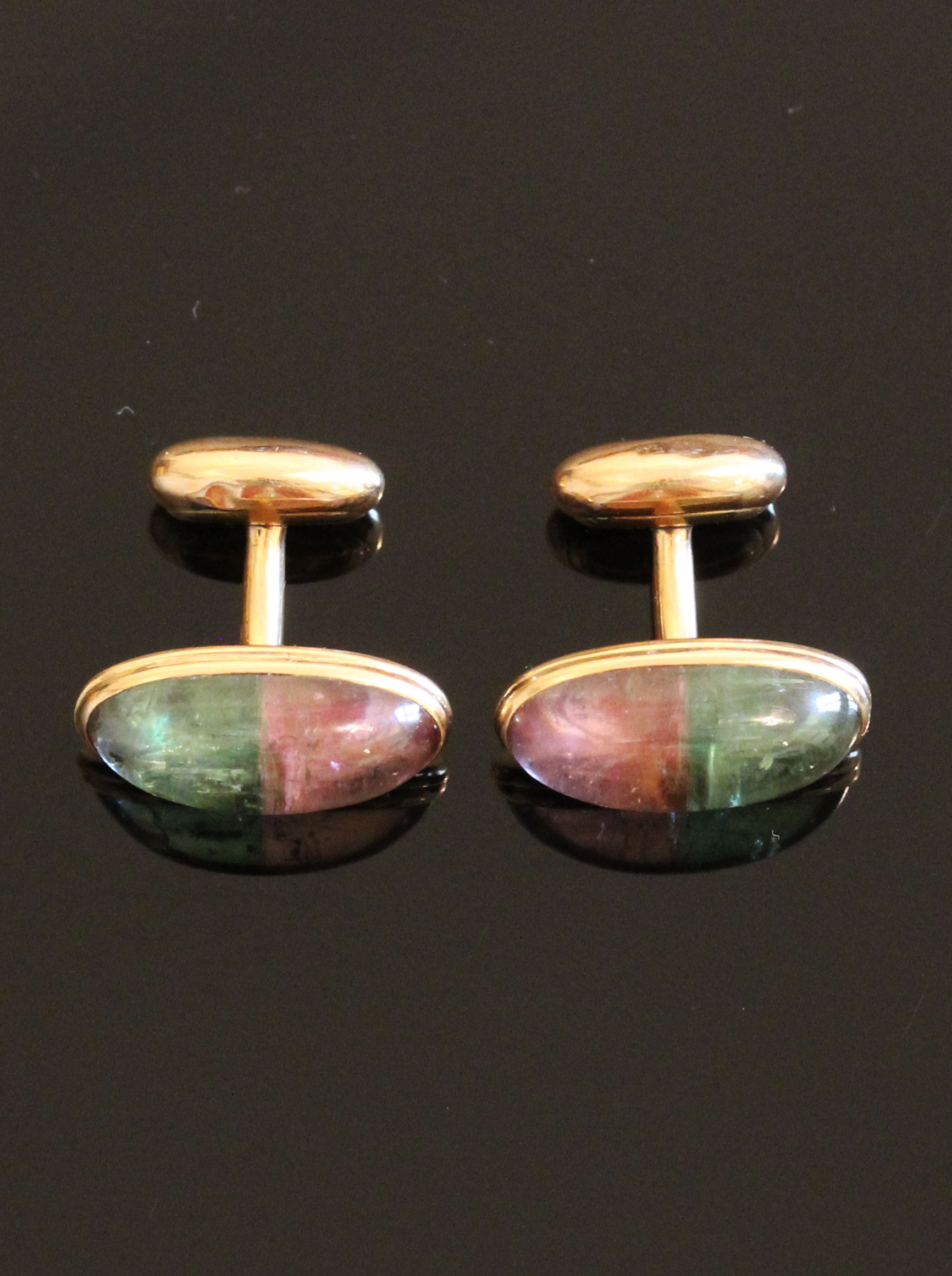 Rare gold cufflinks with a watermelon tourmaline