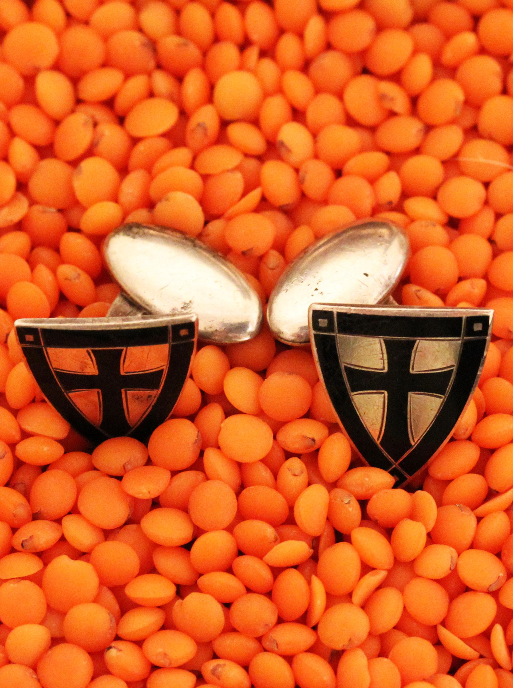 Cufflinks with a knight shield